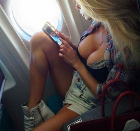 Big boobs blonde on a plane