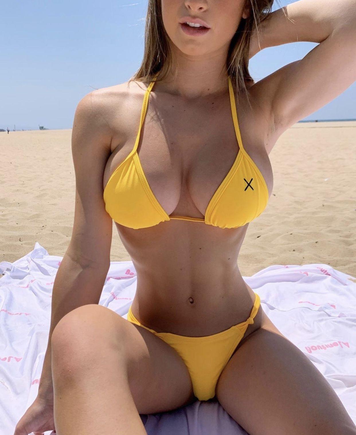 Beauty on the beach in yellow bikini