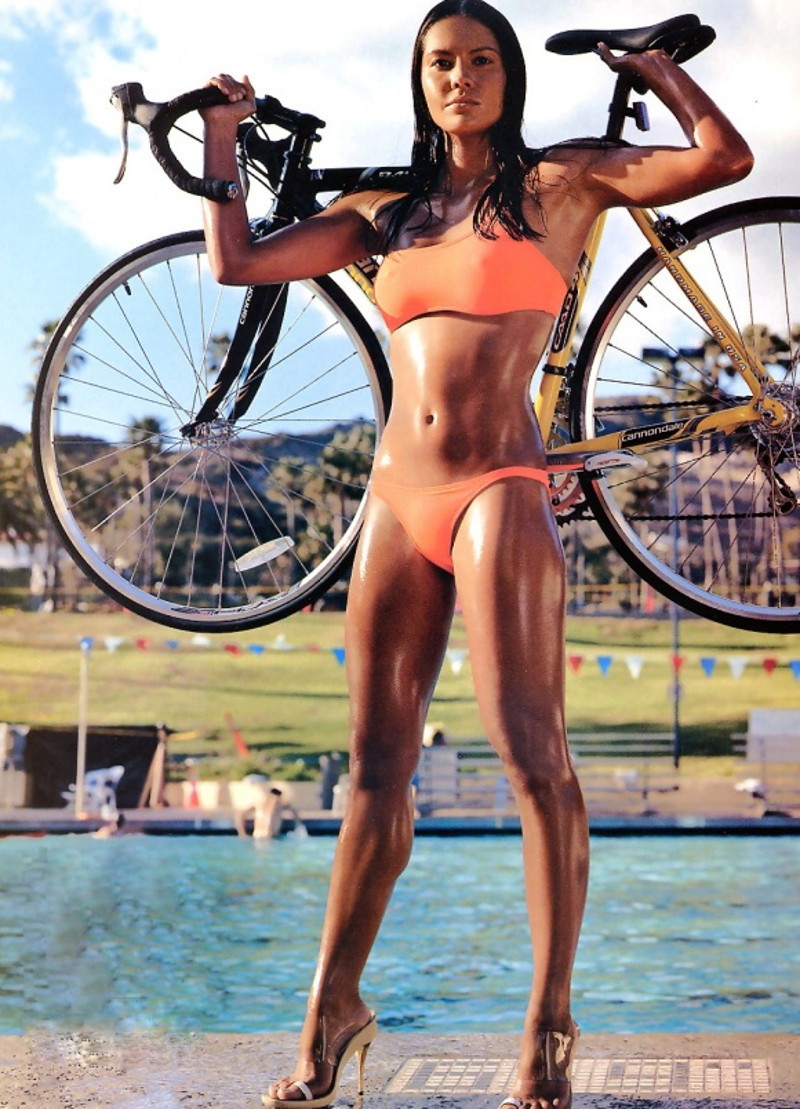 Fit and oiled up babe uses her bike