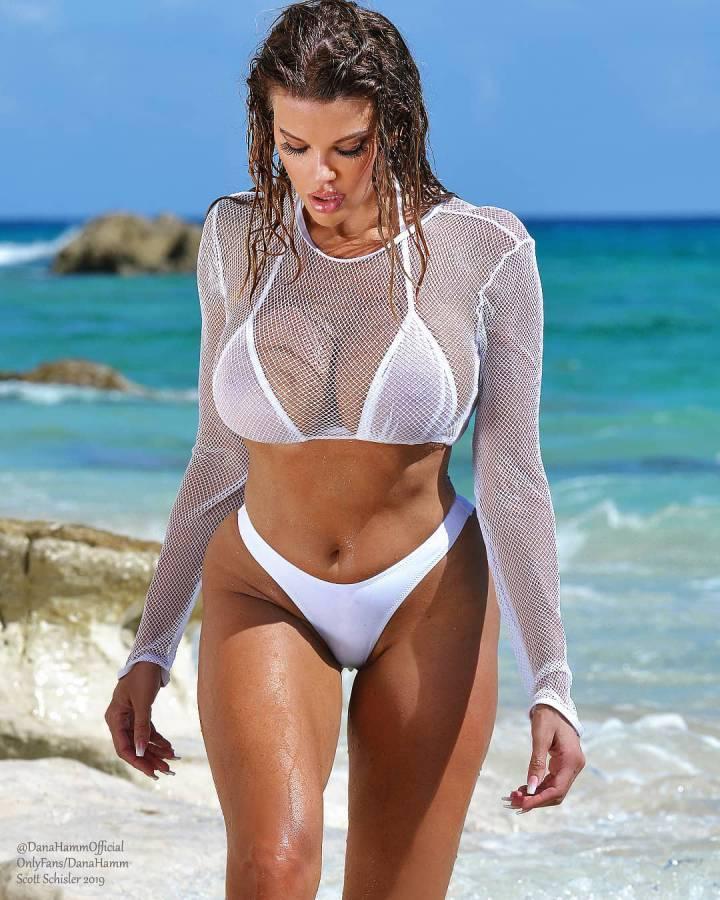 Massive tits on beach babe